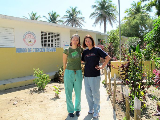 Jennifer Sbicca, a third-year medical student at the UF College of Medicine (left) and her mom, Anne Claiborne, MD '79, a radiologist in Orlando, stand beside a clinic on the Dominican Republic-Haitian border. The pair went on a health trip organized by UF's Project Haiti volunteers in March 2011.