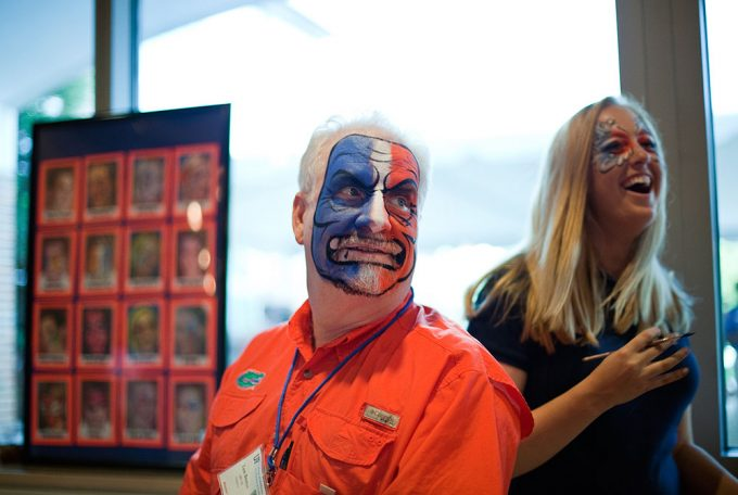 Tom Benton, MD '85, shows off his orange and blue face paint at the UF College of Medicine Alumni Reunion's tailgate party.