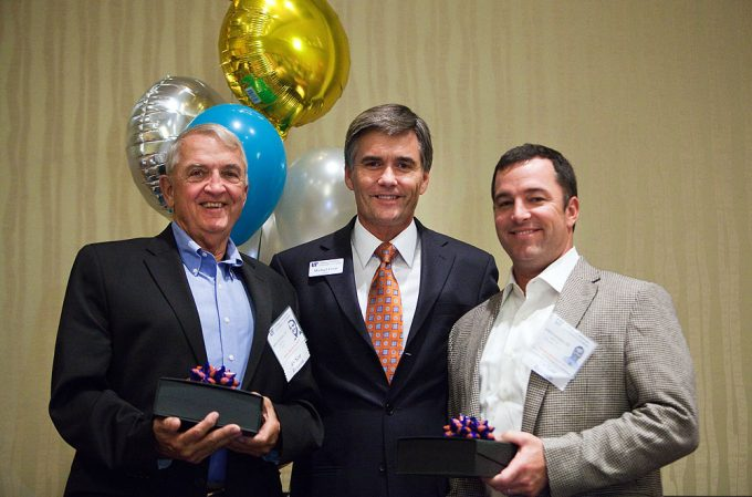 UF College of Medicine Dean Michael L. Good presented the Dean's Award for Humanitarian Service to father and son graduates, John F. Lovejoy Jr., MD '66, and John F. Lovejoy III, MD '01, for their service in Haiti.