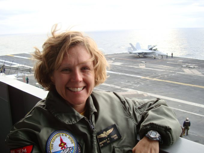 Pictured in front of the flight deck of the U.S.S. George H.W. Bush CVN-77 is Kimberly P. Toone, MD '97, senior medical officer aboard one of the largest U.S. Navy aircraft carriers in the world.