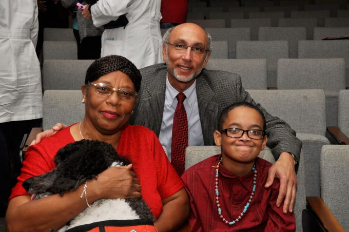 Marian Williams and her grandson Taubri Jackson pose with Jeff Goldhagen, MD.