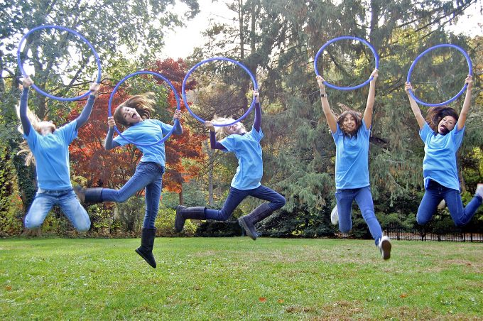 """Annalise Mozer (first on left) and her friends, """"theDiabetes Divas for the Cure,"""" tied for first place in the UF's Diabetes Center of Excellence """"Blue Circles for Diabetes"""" photo contest in November 2010.Photo provided by the Mozer family."""