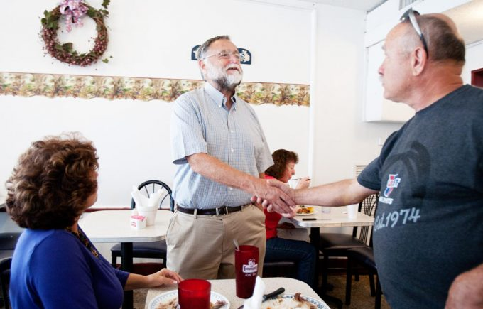 Dr. Larry Rooks greets local residents Jarrett and Helen Liles at a local restaurant. Jarrett was an EMT for Dixie County about 20 years ago. Close-knit Dixie County has one high school and locals say everyone knows everyone. Photo by Maria Belen Farias