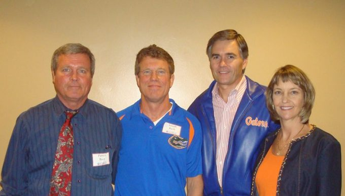 (From left) Patrick Rush and Joseph Rush, MD, with Dr. Michael Good, dean of the UF College of Medicine, and his wife, Danette.