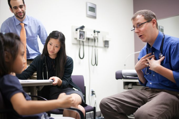 First-year medical students, Isaac Luria, Jennifer Kuo and Khalil Harbie, interview standardized patient Annie Hu, 6.