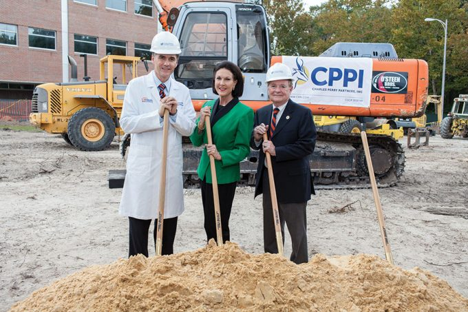 Michael Good, MD, dean of the UF College of Medicine, left, and Claudia and Alan Porter, MD '71, attended the George T. Harrell, MD, Medical Education Building groundbreaking Nov. 22. Photo by Jesse S. Jones