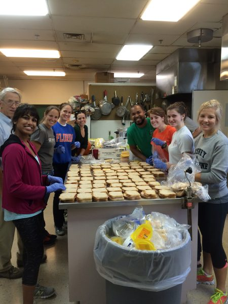 PA students volunteering to cook meals